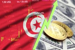 Tunisia flag and cryptocurrency growing trend with two bitcoins on dollar bills. Concept of raising Bitcoin in price against the dollar stock illustration