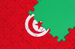 Tunisia flag is depicted on a completed jigsaw puzzle with free green copy space on the right side.  stock images