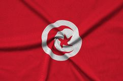 Tunisia flag is depicted on a sports cloth fabric with many folds. Sport team banner. Tunisia flag is depicted on a sports cloth fabric with many folds. Sport stock photos