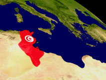 Tunisia with flag on Earth Royalty Free Stock Photos