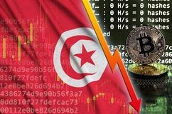 Tunisia flag and falling red arrow on bitcoin mining screen and two physical golden bitcoins. Concept of low conversion in cryptocurrency mining royalty free illustration