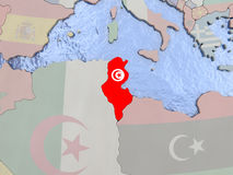 Tunisia with flag on globe Stock Photos