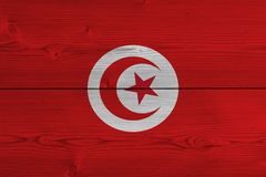 Tunisia flag painted on old wood plank. Patriotic background. National flag of Tunisia stock photography