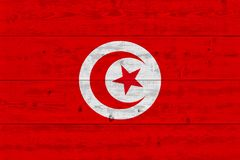 Tunisia flag painted on old wood plank. Patriotic background. National flag of Tunisia royalty free stock image