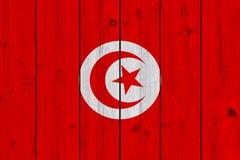 Tunisia flag painted on old wood plank. Patriotic background. National flag of Tunisia stock photo