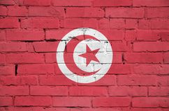 Tunisia flag is painted onto an old brick wall royalty free stock photo