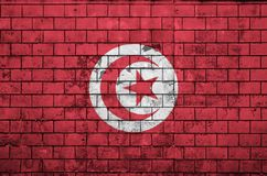 Tunisia flag is painted onto an old brick wall stock photos