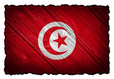 Tunisia flag. Painted on wooden tag. Isolated on white background royalty free stock photography
