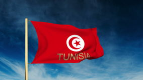 Tunisia flag slider style with title. Waving in. Tunisia flag slider style with title. Waving with cloud background animation stock footage