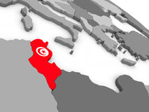 Tunisia on globe with flag Stock Images