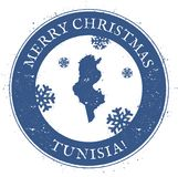 Tunisia map. Vintage Merry Christmas Tunisia. Tunisia map. Vintage Merry Christmas Tunisia Stamp. Stylised rubber stamp with county map and Merry Christmas text Stock Photo