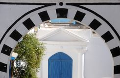 Tunisia. Sidi Bou Said. Typical building with white walls, blue doors and windows Stock Images