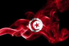 Tunisia smoke flag. Isolated on a black background royalty free stock photos