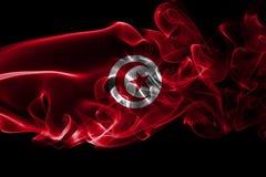 Tunisia smoke flag. Isolated on a black background stock photo