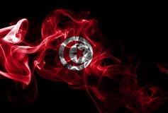 Tunisia smoke flag. Isolated on a black background royalty free stock photo