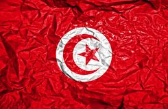 Tunisia vintage flag on old crumpled paper background royalty free stock photo