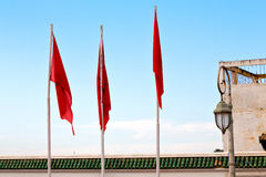 Tunisia  waving   in the blue sky   and battlements  wave Royalty Free Stock Images