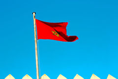 Tunisia  waving flag in the blue    colour and battlements  wave Stock Photos