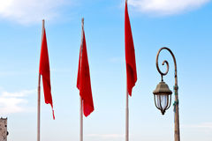 Tunisia  waving flag in the blue   colour and street lamp Royalty Free Stock Photo