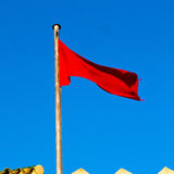 Tunisia  waving flag in the blue sky  colour and battlements  wa Royalty Free Stock Photography