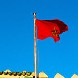 Tunisia  waving flag in the blue sky  colour and battlements  wa Royalty Free Stock Images