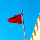 Tunisia  waving flag in the blue sky  colour and battlements  wa Stock Image