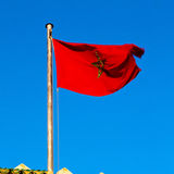 Tunisia  waving flag in the blue sky  colour and battlements  wa Stock Photos