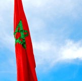 Tunisia  waving flag in the blue sky  colour and battlements  wa Stock Photo