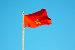 Tunisia  waving flag in the blue sky  colour and battlements Royalty Free Stock Photo