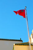 Tunisia  waving flag in blue sky  colour and battlements  wave Stock Photography