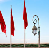 Tunisia  waving flag in the blue sky  colour and street lamp Stock Images