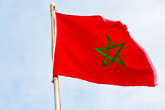 Tunisia  waving flag in the blue sky Stock Image
