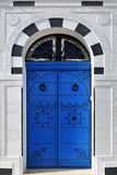 Tunisian blue doors Stock Photo