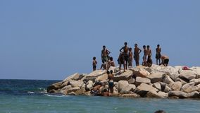 Tunisian boys on breakwater. Tunisian people on breakwater stock video