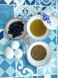 Tunisian breakfast black dry olives oil eggs fibers seseame. Tunisian breakfast: olive oil eggs seseame fibers symbols ceramic bol stock photos