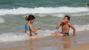 Tunisian children bathing in sea stock video footage