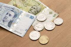 Tunisian currency, Tunisian dinars. On wooden table background Royalty Free Stock Image