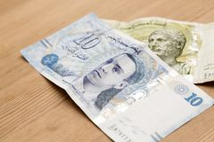 Tunisian currency, Tunisian dinars. On wooden table background Stock Photos