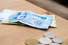 Tunisian currency, Tunisian dinars. On wooden table background Royalty Free Stock Photos