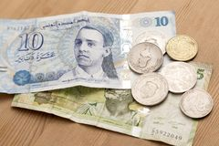 Tunisian currency, Tunisian dinars. On wooden table background Royalty Free Stock Images