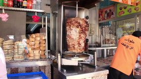 Tunisian fast food stand. TUNISIA, SOUSSE, JULY 10, 2010: Grill. Tunisian cuisine. Doner kebab being cooked at a fast food restaurant in Tunisia, Sousse, July 10 stock video