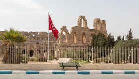 The Tunisian flag and archaeological thThe Tunisian flag and archaeological theater in El Jemeater in El Jem, Tunisia. The Tunisian flag and archaeological stock image