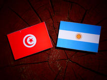 Tunisian flag with Argentinian flag on a tree stump royalty free stock photos