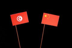 Tunisian flag with Chinese flag on black. Background royalty free stock photo