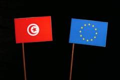 Tunisian flag with European Union EU flag  on black. Background Royalty Free Stock Image