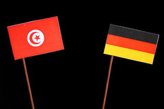 Tunisian flag with German flag on black. Background stock image