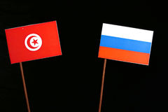 Tunisian flag with Russian flag on black. Background stock images