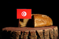 Tunisian flag on a stump with bread stock photography