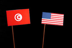 Tunisian flag with USA flag on black. Background royalty free stock photography