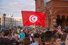 Tunisian football fans with flag on red Square. Football world Cup. MOSCOW, RUSSIA - June 16, 2018: Tunisian football fans with flag on red Square. Football royalty free stock photo